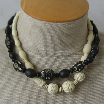 Black painted then carved and ivory-color carved celluloid 1930's necklaces - Costume Jewelry