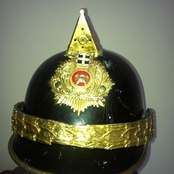 unknown fire helmet, help with any info please