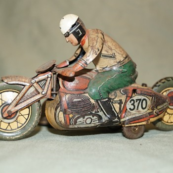 Motorcycle and sidecar tin toy - Toys