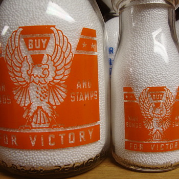 WAR SLOGAN EAGLE DESIGN IN QUART AND 1/2 PINT SIZES.....EAGLE...BUY WAR BONDS & STAMPS - Bottles