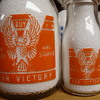 WAR SLOGAN EAGLE DESIGN IN QUART AND 1/2 PINT SIZES.....EAGLE...BUY WAR BONDS & STAMPS