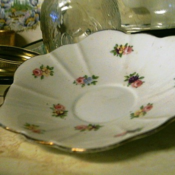 I think this is a saucer but it is a little deep - China and Dinnerware