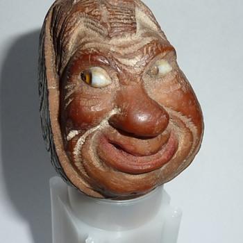 Carved wooden bottle stopper with glass eyes , cork stopper. - Folk Art