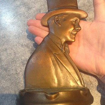 Metallic? ashtray with outline of Man in top hat attached