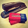 Swingline stapler and two full boxes of Swingline staples
