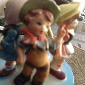 Four Porcelain Children on a working music box  - Figurines