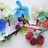 A collection of vintage pre-WW2 glass flowers Czech brooches