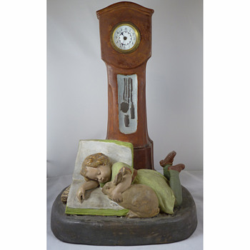 A Goldscheider Pottery Nursery Clock - A Child and Her Pet Rabbit circa 1900  - Figurines