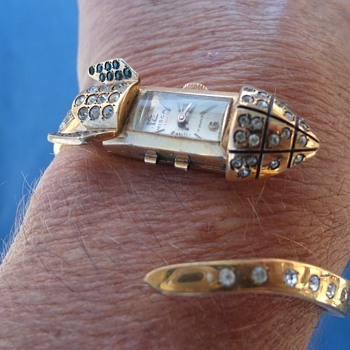 I found this one-of-a-kind rocket ship watch in an antique shop in Prague.   - Costume Jewelry