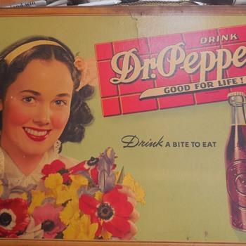Dr. Pepper cardboard signs.