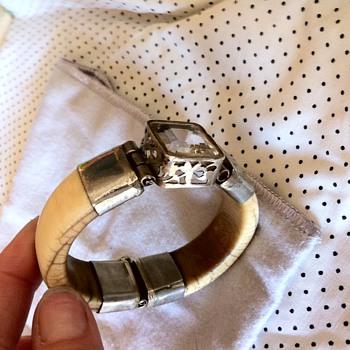 Ivory bracelet with center stone on silver hinge