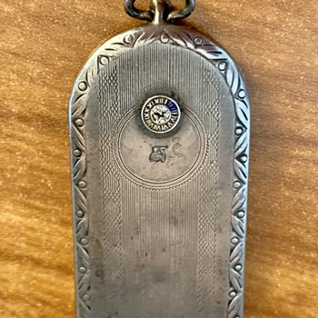 What is it??  Maybe a watch fob?? - Accessories
