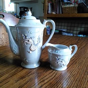 Beautiful porcelain Tea Pot and Creamer by Maruku made in Japan.