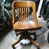 Swiveling oak desk chair