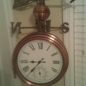 weathervane/ double sided clock/ temperature gauge