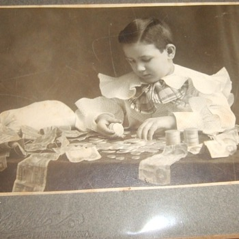 Antique photograph of a boy banker with King of Bills