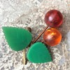 Brass and lucite cherry brooch