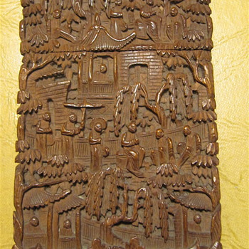 Carved wood cardholder from China.Like to know more about it. There is signature inside the box.