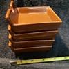 set of four brown ceramic ashtrays