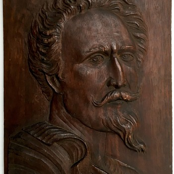 Wooden relief plaque