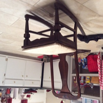 Old armless rocking chair