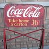 Coke bottle rack sign