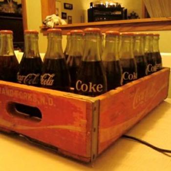 Unopened Coke bottles & crate - Coca-Cola