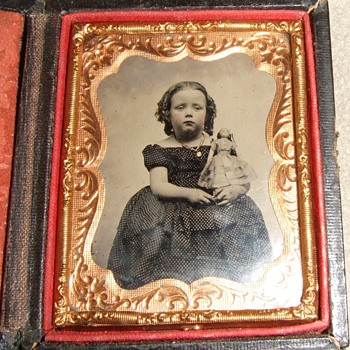 Tintype of girl holding her doll - Dolls