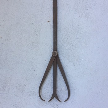 I think it's a ice tong - Tools and Hardware
