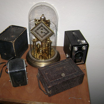 Small camera collection and grandmas clock. - Cameras