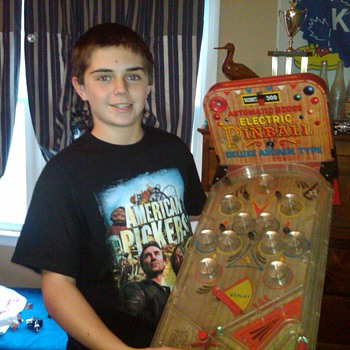 James with his small electric pinball game