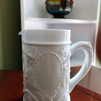 Need ID please for this Milk Glass Jug/Creamer with leaves, grapes and 'vine' handle.   - Glassware