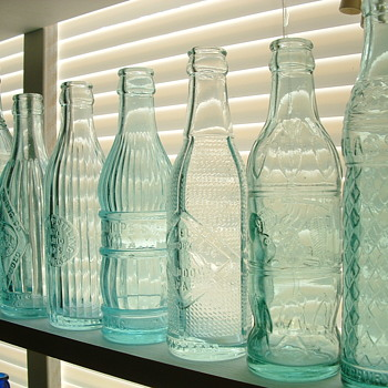Art Deco Soda's in ice blue shades - Bottles