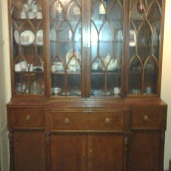 antique glass door bookshelf with built in desk lion head drawer handles.