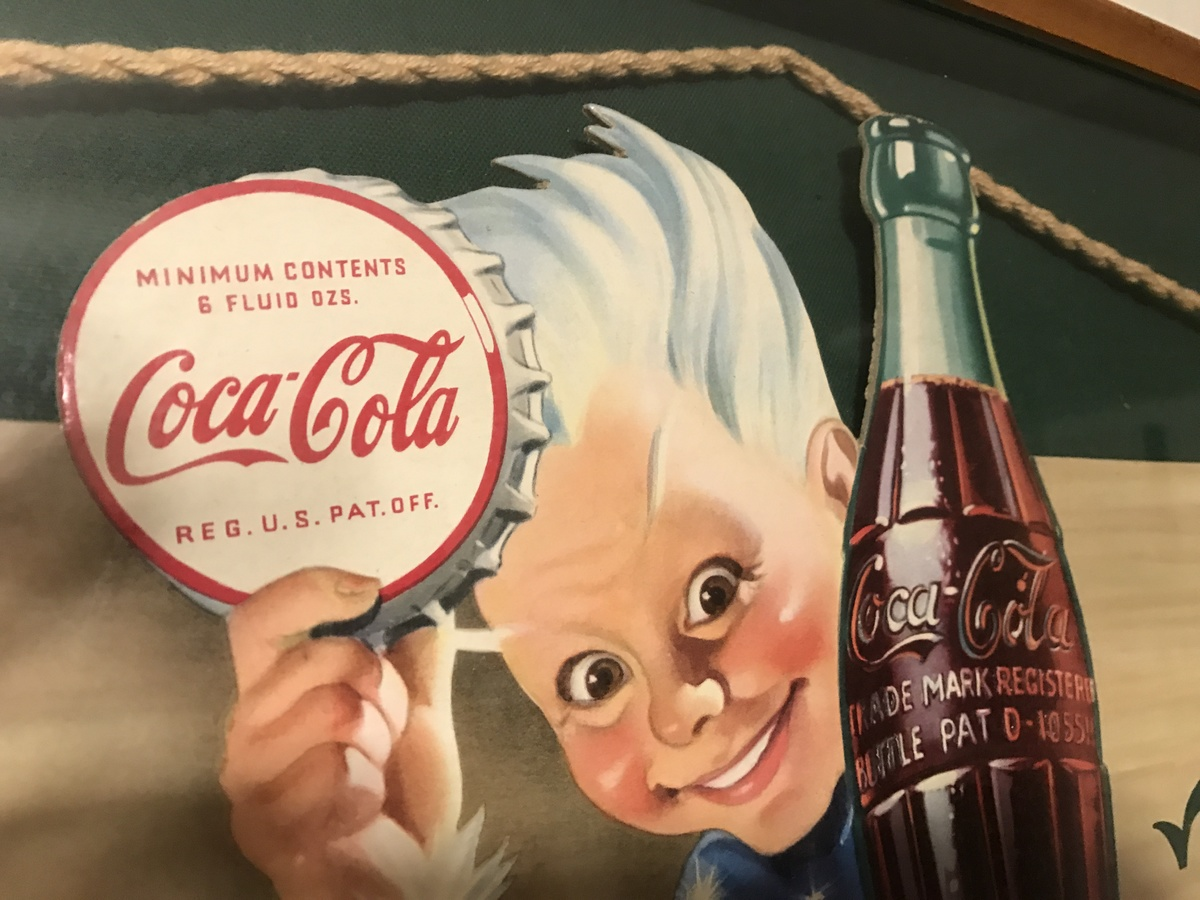 Sprite Boy Sparkles in this beautiful 1944 Coke sign