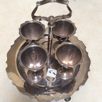 Saturday Rummsge Sale Find old egg cups on stand - Silver