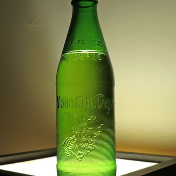 1967 Mountain Dew Hillbilly Soda Bottle Embossed Green Full Sealed Unopened Capped NDNR Vintage Collectible - Bottles