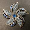 Pell pinwheel flower brooch