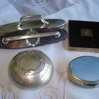 A sterling box with mirror