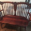 Mahogany bench with face and lions