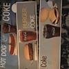 Coca Cola cardboard signs