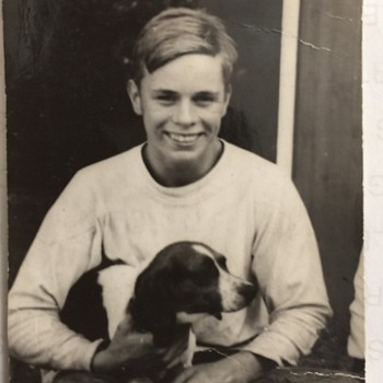 1950's  unknown Artist Photograph holding his Dog, a Spaniel  - Photographs