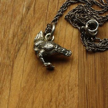 Small silver chicken charm