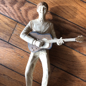 Plastic musician playing guitar.  - Dolls