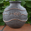 Vase Decorated with Three  Incised  Fish and raised water decoration.