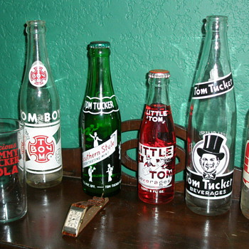 Tom Tucker soda bottle's, watch, poster, and label - Bottles