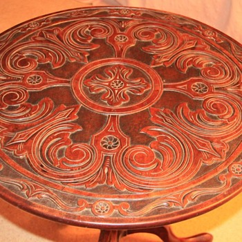 Tilt top table  with carved surface