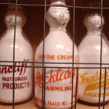ROCKLEDGE FARM DAIRY...CENTRAL FALLS RHODE ISLAND COP THE CREAM MILK BOTTLE - Bottles