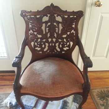 antique  hand carved wooden back chair