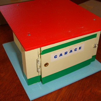 garage with a small doll prank joke from the 50's - Toys